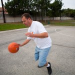 John playing basketball in a park