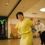 Ilene dancing in a yellow dress