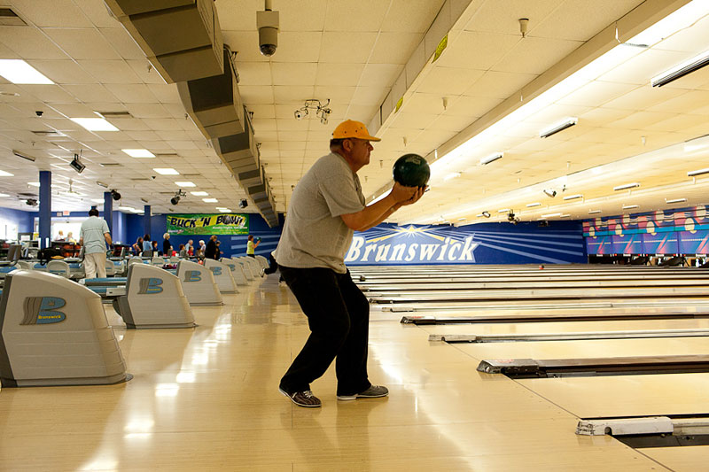 Martin getting ready to roll the ball at a bowling alley