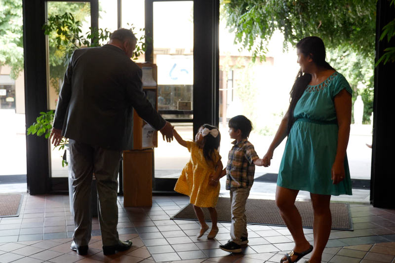 Martin greeting two children and their mother at his church