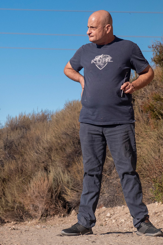 Grant standing on a trail