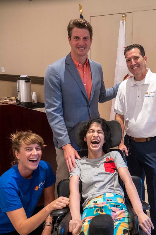 Kimi posing with a California legislatives and JNCS staff