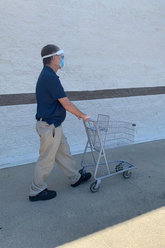 James pushing a shopping cart