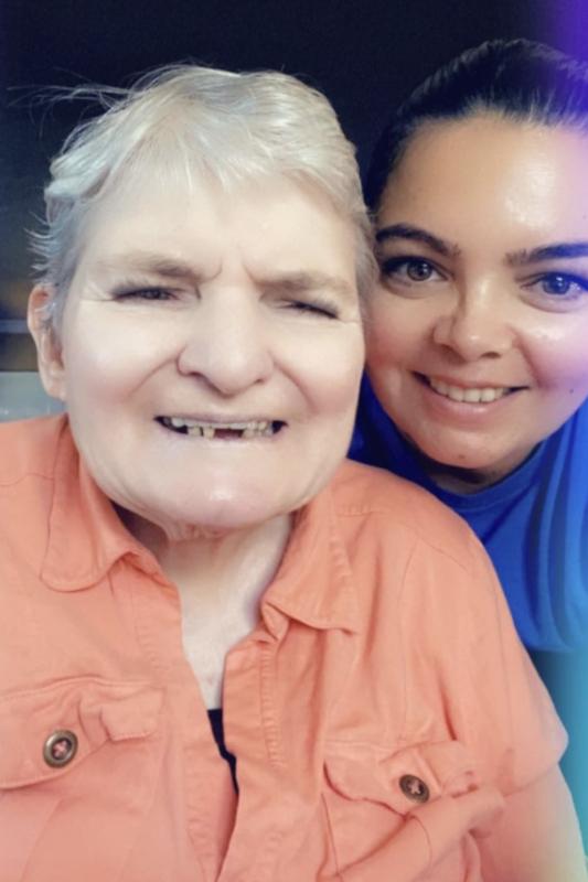 Irene & Gloria smiling at the camera