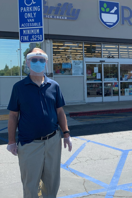 James in a full face mask standing in front of Rite Aid, his workplace
